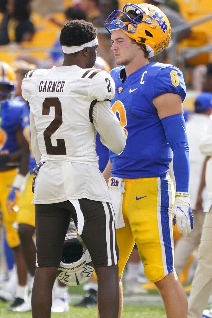 Pittsburgh quarterback Kenny Pickett (8) greets Western Michigan safety Bricen Garner (2) after an NCAA college football game, Saturday, Sept. 18, 2021, in Pittsburgh. Western Michigan won 44-41. (AP Photo/Keith Srakocic)