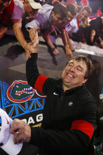 Georgia coach Kirby Smart celebrates with fans after the team's win over Florida in an NCAA college football game Saturday, Nov. 2, 2019, in Jacksonville, Fla. (Joshua L. Jones/Athens Banner-Herald via AP)