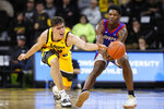 Iowa center Luka Garza, left, tries to steal the ball from DePaul forward Romeo Weems during the second half of an NCAA college basketball game, Monday, Nov. 11, 2019, in Iowa City, Iowa. DePaul won 93-78. (AP Photo/Charlie Neibergall)