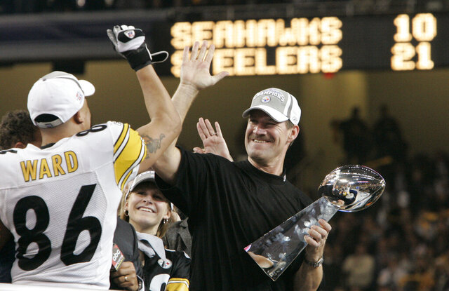 FILE - In this Sunday, Feb. 5, 2006 file photo, Pittsburgh Steelers head coach Bill Cowher high-fives Hines Ward (86), MVP of the Super Bowl XL football game, after they defeated the Seattle Seahawks, 21-10 in Detroit. Former Pittsburgh Steelers coach Bill Cowher has been elected to the Pro Football Hall of Fame. Cowher, an analyst for CBS, was surprised by the announcement made live on air in studio before the Tennessee Titans-Baltimore Ravens AFC divisional round playoff game Saturday night, Jan. 11, 2020. (AP Photo/Elaine Thompson, File)