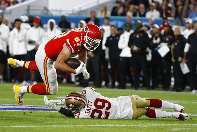Kansas City Chiefs' Travis Kelce (87) runs against San Francisco 49ers' Jaquiski Tartt (29) during the first half of the NFL Super Bowl 54 football game Sunday, Feb. 2, 2020, in Miami Gardens, Fla. (AP Photo/Mark Humphrey)