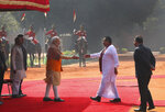 Indian Prime Minister Narender Modi, center left, greets his Sri Lankan counterpart Mahinda Rajapaksa, during a ceremonial reception at the Indian presidential palace, in New Delhi, India, Saturday, Feb. 8, 2020. Rajapaksa is on a four day state visit to India. (AP Photo/Manish Swarup)