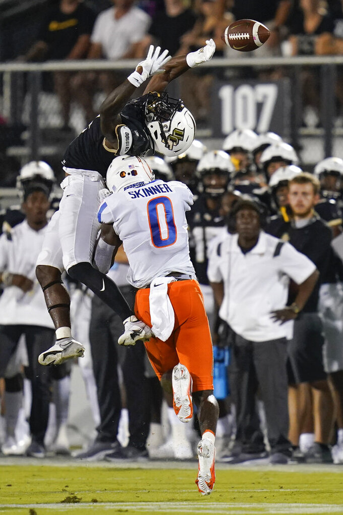 Boise State safety JL Skinner (0) breaks up a pass intended for Central Florida wide receiver Ryan O'Keefe during the first half of an NCAA college football game Thursday, Sept. 2, 2021, in Orlando, Fla. (AP Photo/John Raoux)