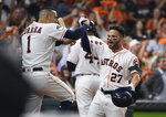 Houston Astros second baseman Jose Altuve (27) celebrates his solo home run against the Tampa Bay Rays with Carlos Correa (1) during the eighth inning of Game 5 of a baseball American League Division Series in Houston, Thursday, Oct. 10, 2019. (AP Photo/Eric Christian Smith)