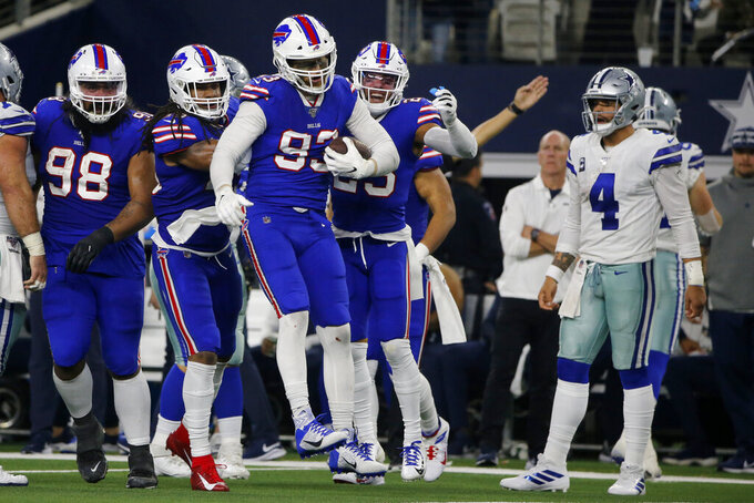 Buffalo Bills defensive tackle Star Lotulelei (98), Tremaine Edmunds (49), Trent Murphy (93) and Micah Hyde (23) celebrate a Dallas Cowboys quarterback Dak Prescott (4) fumble recovered by Murphy in the first half of an NFL football game in Arlington, Texas, Thursday, Nov. 28, 2019. (AP Photo/Michael Ainsworth)