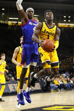 Iowa guard Joe Toussaint drives to the basket ahead of DePaul forward Paul Reed (4) during the second half of an NCAA college basketball game, Monday, Nov. 11, 2019, in Iowa City, Iowa. DePaul won 93-78. (AP Photo/Charlie Neibergall)