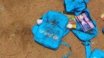 Children's backpacks are discarded a day after an airstrike in Saada, Yemen on Friday, Aug. 10, 2018. Yemen's Shiite rebels are backing a United Nations' call for an investigation into a Saudi-led coalition airstrike in the country's north that killed dozens of people the previous day, including many children.(AP Photo/Kareem al-Mrrany)