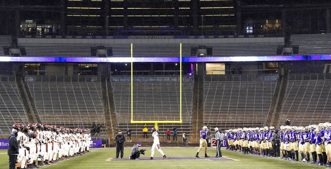 Oregon State, left, and Washington players stand on the field for a socially distanced show of support for Black Lives Matter, before an NCAA college football game Saturday, Nov. 14, 2020, in Seattle. (AP Photo/Ted S. Warren)
