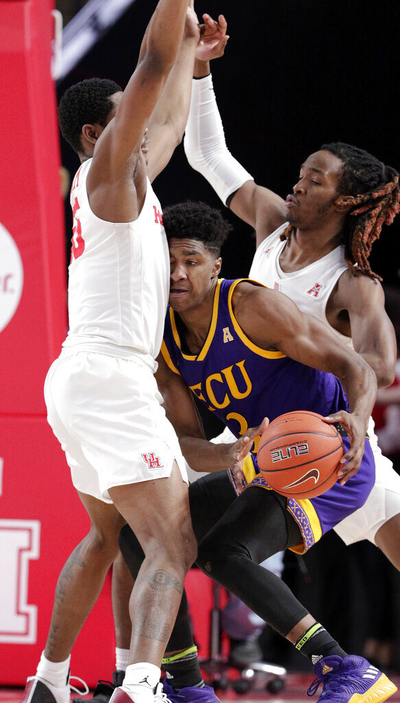 East Carolina forward Seth LeDay (3) collides with Houston forward Brison Gresham, left, as Houston forward Cedrick Alley Jr., back, defends during the second half of an NCAA college basketball game Wednesday, Jan. 23, 2019, in Houston. (AP Photo/Michael Wyke)