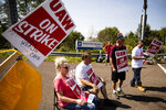 Workers and their supporters picket outside a General Motors facility in Langhorne, Pa., Monday, Sept. 23, 2019. The strike against General Motors by 49,000 United Auto Workers entered its second week Monday with progress reported in negotiations but no clear end in sight. (AP Photo/Matt Rourke)