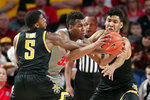 Houston forward Fabian White Jr. (35) pushes a drive between Wichita State forward Trey Wade (5) and center Jaime Echenique (21) during the first half of an NCAA college basketball game Sunday, Feb. 9, 2020, in Houston. (AP Photo/Michael Wyke)