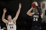 Gonzaga's Corey Kispert, right, shoots next to St. Mary's Alex Ducas during the first half of an NCAA college basketball game Saturday, Feb. 8, 2020, in Moraga, Calif. (AP Photo/Ben Margot)