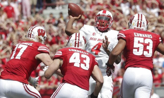 FILE - In this Saturday, Sept. 8, 2018, file photo, Wisconsin linebackers, from left, Andrew Van Ginkel, Ryan Connelly and T.J. Edwards pressure New Mexico quarterback Sheriron Jones (4) during the second half of an NCAA college football game against Wisconsin, in Madison, Wis. The Badgers remain a work in progress on defense as they prepare for their Big Ten opener this weekend against Iowa. Normally one of the top units in the nation, the 18th-ranked Badgers have been dented this year in non-conference play. (AP Photo/Morry Gash, File)