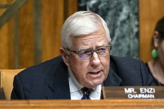FILE - In this March 27, 2019, file photo, Sen. Mike Enzi, R-Wyo., chairman of the Senate Budget Committee, makes an opening statement on the fiscal year 2020 budget resolution, on Capitol Hill in Washington. Recently retired U.S. Sen. Mike Enzi of Wyoming died Monday, July 26, 2021. He was 77 years old. (AP Photo/J. Scott Applewhite, File)