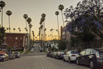 In this Thursday, May 21, 2020, photo vehicles are parked in Los Angeles. The coronavirus hasn't been kind to car owners. With more people than ever staying home to lessen the spread of COVID-19, their sedans, pickup trucks and SUVs are parked unattended on the streets, making them easy targets for opportunistic thieves.   (AP Photo/Damian Dovarganes)