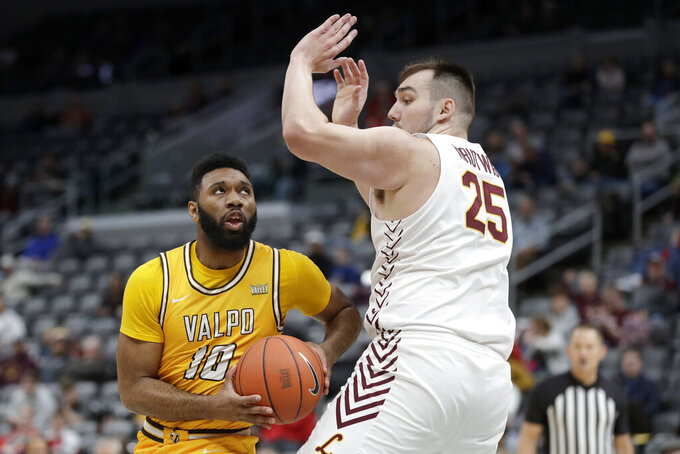 Valparaiso's Eron Gordon (10) heads to the basket as Loyola of Chicago's Cameron Krutwig (25) defends during the first half of an NCAA college basketball game in the quarterfinal round of the Missouri Valley Conference men's tournament Friday, March 6, 2020, in St. Louis. (AP Photo/Jeff Roberson)