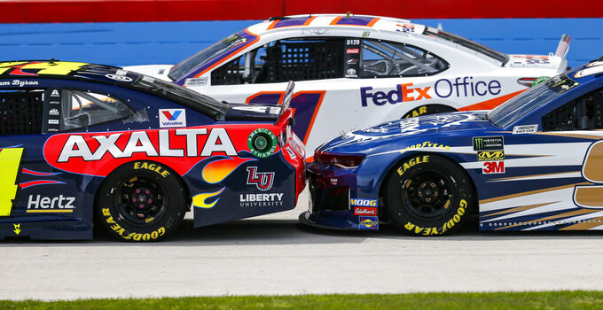 Driver Chase Elliott, right, bumps the back of William Byron's car during a NASCAR Cup auto race at Texas Motor Speedway, Sunday, March 31, 2019, in Fort Worth, Texas. (AP Photo/Brandon Wade)