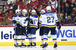 St. Louis Blues defenseman Vince Dunn (29) celebrates his goal with center Brayden Schenn (10), defenseman Alex Pietrangelo (27) and others during the second period of an NHL hockey game against the Washington Capitals, Monday, Jan. 14, 2019, in Washington. (AP Photo/Nick Wass)