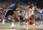 Auburn forward Horace Spencer, left, fights for a loose ball with Virginia guard De'Andre Hunter during the first half in the semifinals of the Final Four NCAA college basketball tournament, Saturday, April 6, 2019, in Minneapolis. (AP Photo/Jeff Roberson)