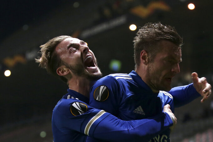 Leicester's James Maddison hugs teammate Jamie Vardy, right, after he scored their side's third goal during the Europa League group G soccer match between SC Braga and Leicester City at the Municipal stadium in Braga, Portugal, Thursday, Nov. 26, 2020. (AP Photo/Luis Vieira)