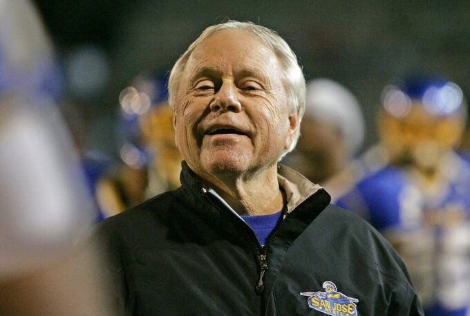 FILE - In this Friday, Nov. 21, 2008, file photo, then San Jose State head coach Dick Tomey smiles in the first quarter against Fresno State during an NCAA college football game in San Jose, Calif. Tomey, the winningest football coach in University of Arizona history, died Friday night, May 10, 2019, in Tucson, Ariz. He was 80. Tomey was 183-145-7 overall in 20 years as head coach at Hawaii, Arizona and San Jose State. He was diagnosed with lung cancer in December.   (AP Photo/Paul Sakuma, File)