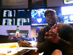 FILE - In this Oct. 12, 2018 file photo, Brian James, of New York, discusses his bets for the upcoming weekend of football in the sports betting lounge at the Ocean Resort Casino in Atlantic City, N.J. At least $9 billion has been bet — legally — on sports in the U.S. in the year since New Jersey's Supreme Court victory cleared the way for other states to do it.(AP Photo/Wayne Parry, File