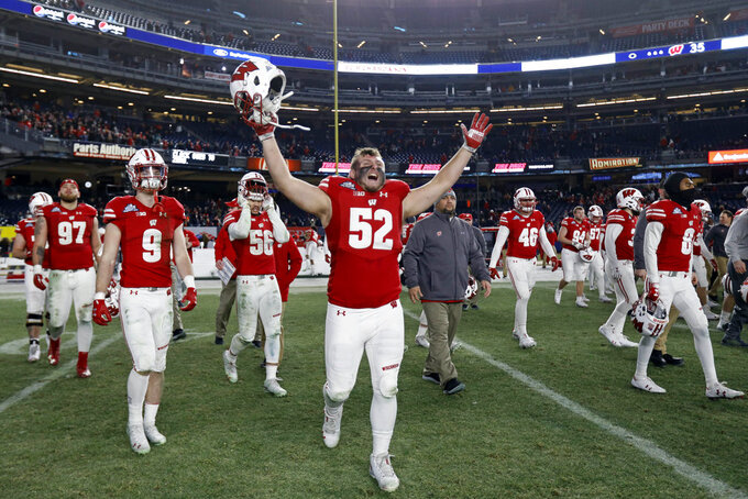Wisconsin defensive end David Pfaff (52) and teammates celebrate after Wisconsin defeated Miami 35-3 in the Pinstripe Bowl NCAA college football game Thursday, Dec. 27, 2018, in New York. (AP Photo/Adam Hunger)
