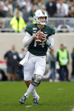 Michigan State quarterback Brian Lewerke looks to throw against Indiana during the first quarter of an NCAA college football game, Saturday, Sept. 28, 2019, in East Lansing, Mich. (AP Photo/Al Goldis)
