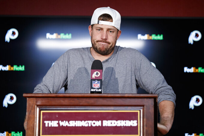 "Washington Redskins quarterback Case Keenum pauses while speaking during a news conference after an NFL football game against the Dallas Cowboys, Sunday, Sept. 15, 2019, in Landover, Md. The Redskins face injury and defensive questions after falling to 0-2 with a loss to the Dallas Cowboys and the Chicago Bears coming to town for ""Monday Night Football.""  (AP Photo/Alex Brandon)"