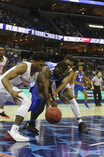Memphis player Rayne Thornton tries to maintain control of the ball against Houston's Nate Hinton and Prison Gresham in the first half of an NCAA college basketball game at the American Athletic Conference tournament Saturday, March 16, 2019, in Memphis, Tenn. (AP Photo/Troy Glasgow)