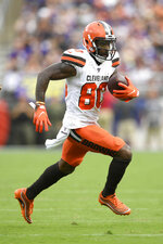 FILE - In this Sept. 29, 2019, file photo, Cleveland Browns wide receiver Jarvis Landry runs with the ball against the Baltimore Ravens during the third quarter of an NFL football game Sunday in Baltimore. Landry, who did not return to the game after that play, remains in concussion protocol following the game in which he caught eight passes for a career-high 167 yards in Sunday's 40-25 victory. Coach Freddie Kitchens said Thursday that Landry is still out, and it's not yet known if he'll be available Monday night when the Browns (2-2) visit the San Francisco 49ers (3-0). Landry has also been returning punts this season. (AP Photo/Nick Wass, File)