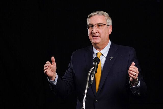 Indiana Republican Gov. Eric Holcomb participates in the Indiana Gubernatorial debate with Democrat Woody Myers and Libertarian Donald Rainwater, Tuesday, Oct. 27, 2020, in Indianapolis. The candidates were in separate studios to allow for social distancing guidelines. (AP Photo/Darron Cummings)