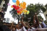Indian friends of Kulbhushan Jadhav, celebrate verdict of International Court of Justice in Mumbai, India, Wednesday, July 17, 2019. The United Nations' highest court has ordered that Pakistan stay the execution of Jadhav, an alleged Indian spy and ordered that his case be reviewed after agreeing with India's contention that his rights had been violated. (AP Photo/Rajanish Kakade)