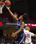Connecticut guard Christyn Williams (13) goes to the basket followed by Temple forward Alexa Williamson (20) during the first half of an NCAA college basketball game Sunday, Nov. 17, 2019, in Philadelphia. (AP Photo/Laurence Kesterson)