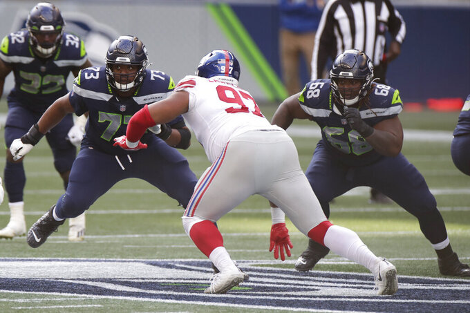 Seattle Seahawks offensive tackle Jamarco Jones (73) and offensive guard Damien Lewis (68) square off against New York Giants defensive tackle Dexter Lawrence (97) during the first half of an NFL football game, Sunday, Dec. 6, 2020, in Seattle. (AP Photo/Larry Maurer)