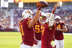 Iowa State tight end Chase Allen (11) celebrates with teammate Xavier Hutchinson after catching a 2-yard touchdown pass during the first half of an NCAA college football game against Texas Tech, Saturday, Oct. 10, 2020, in Ames, Iowa. (AP Photo/Charlie Neibergall)