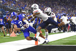 BYU wide receiver Neil Pau'u (2) scores a touchdown against Arizona during the second half of an NCAA college football game Saturday, Sept. 4, 2021, in Las Vegas. (AP Photo/David Becker)
