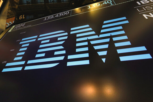 FILE - In this March 18, 2019, file photo, the logo for IBM appears above a trading post on the floor of the New York Stock Exchange.  IBM says it is breaking off a $19 billion chunk of its business to focus on cloud computing. The 109-year-old tech company said Thursday, Oct. 8, 2020,  it is spinning off its managed infrastructure services unit into a new public company, temporarily named NewCo.  (AP Photo/Richard Drew, File)