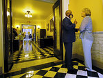 Del. Luke Torian, D-Prince William, left, chairman of the House Appropriations Committee, and Sen. Janet Howell, D-Fairfax, chair of the Senate Finance and Appropriations Committee, confer outside the Virginia Senate chamber inside the Virginia State Capitol in Richmond, Va., Monday, Aug. 2, 2021, the first day of the General Assembly special session. (Bob Brown/Richmond Times-Dispatch via AP)
