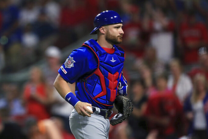 FILE - In this Aug. 10, 2019, file photo, Chicago Cubs' Jonathan Lucroy holds the ball during the team's baseball game against the Cincinnati Reds in Cincinnati. The White Sox agreed to a minor league contract with Lucroy, giving them another option behind Yasmani Grandal. A person familiar with the situation confirmed Chicago's deal Thursday, Feb. 4, 2021, on condition of anonymity because the move was pending a physical. The 34-year-old Lucroy appeared in one game with Boston last season. (AP Photo/Aaron Doster, File)