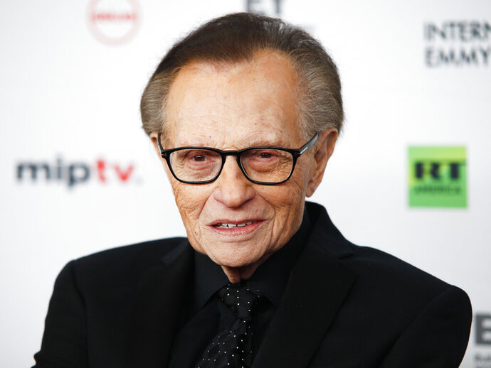 FILE - In this Nov. 20, 2017, file photo, Larry King attends the 45th International Emmy Awards at the New York Hilton, in New York. Former CNN talk show host King has been hospitalized with COVID-19 for more than a week, the news channel reported Saturday, Jan. 2, 2021. CNN reported the 87-year-old King contracted the coronavirus and was undergoing treatment at Cedars-Sinai Medical Center in Los Angeles. (Photo by Andy Kropa/Invision/AP, File)