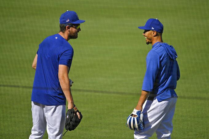 Los Angeles Dodgers center fielder Cody Bellinger, left, talks with right fielder Mookie Betts during the restart of baseball spring training Sunday, July 5, 2020, in Los Angeles. (AP Photo/Mark J. Terrill)