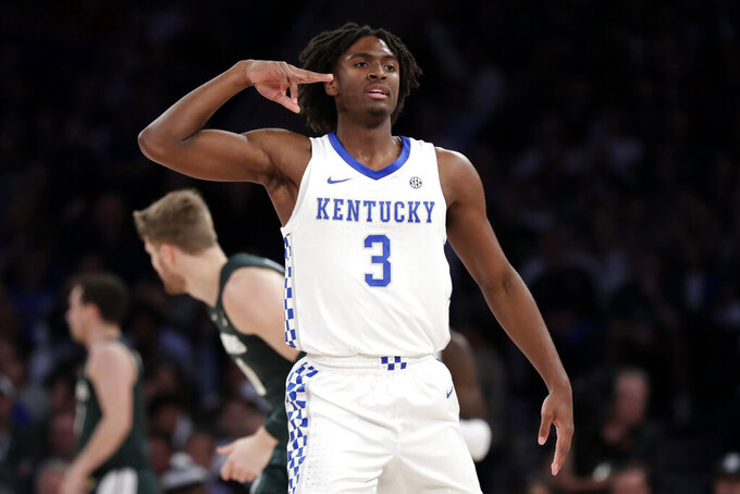 Kentucky guard Tyrese Maxey (3) reacts after making a 3-point basket during the first half of the team's NCAA college basketball game against Michigan State on Tuesday, Nov. 5, 2019, in New York. (AP Photo/Adam Hunger)