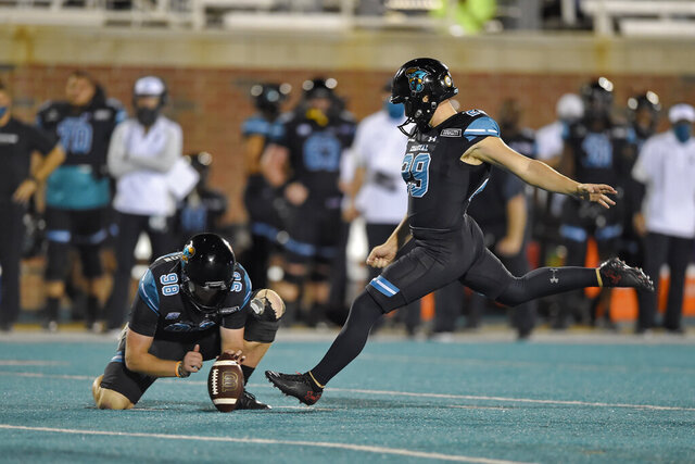 Coastal Carolina's Massimo Biscardi (29) kicks a field goal while Charles Ouverson holds during the second half of an NCAA college football game against South Alabama, Saturday, Nov. 7, 2020, in Conway, S.C. (AP Photo/Richard Shiro)