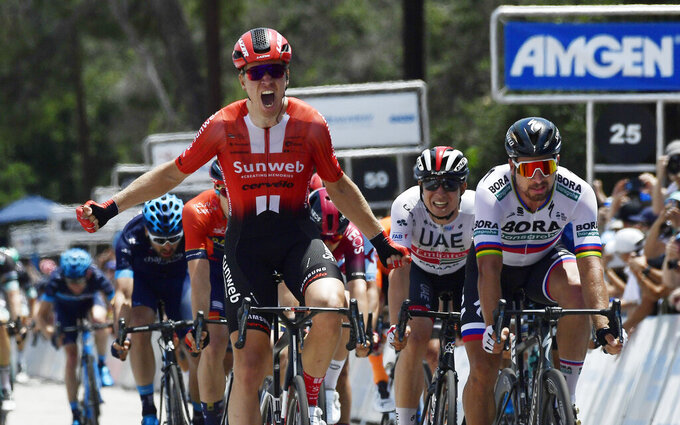 Cees Bol, left, of the Netherlands, edges out Peter Sagan, right, of Slovakia, to win the seventh and final stage of the Tour of California bicycle race Saturday, May 18, 2019, in Pasadena, Calif. (AP Photo/Mark J. Terrill)