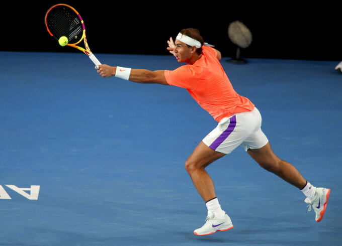 Spain's Rafael Nadal makes a backhand return to Austria's Dominic Thiem during an exhibition tennis event in Adelaide, Australia, Friday, Jan 29. 2021. (Kelly Barnes/AAP Image via AP)