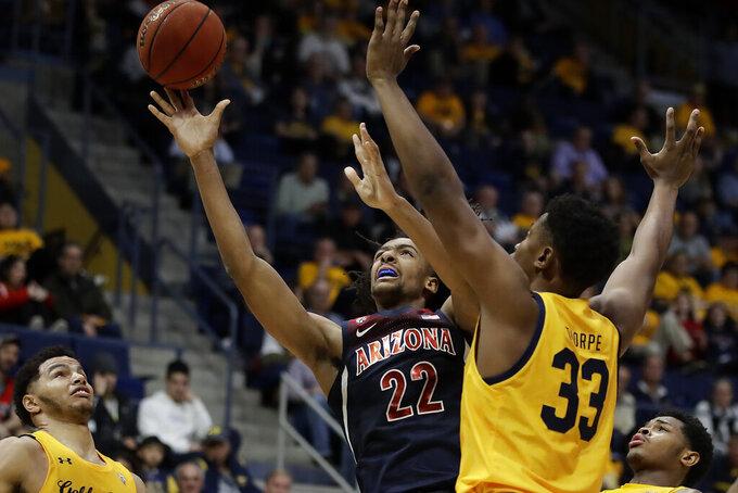 Arizona's Zeke Nnaji, left, shoots past California's D.J. Thorpe (33) during the second half of an NCAA college basketball game Thursday, Feb. 13, 2020, in Berkeley, Calif. (AP Photo/Ben Margot)