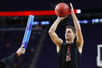 Texas Tech's Davide Moretti (25) warms up during a practice session for the semifinals of the Final Four NCAA college basketball tournament, Friday, April 5, 2019, in Minneapolis. (AP Photo/Charlie Neibergall)