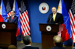 U.S. State Secretary Mike Pompeo, right, answers question during his joint news conference with Philippine Foreign Affairs Secretary Teodoro Locsin Jr. in suburban Pasay city southeast of Manila, Philippines Friday, March 1, 2019. Pompeo, who joined U.S. President Donald Trump in the second summit with North Korean leader Kim Jong-un in Vietnam, is here for talks on the two countries' relations as well as the mutual defense treaty. (AP Photo/Bullit Marquez)