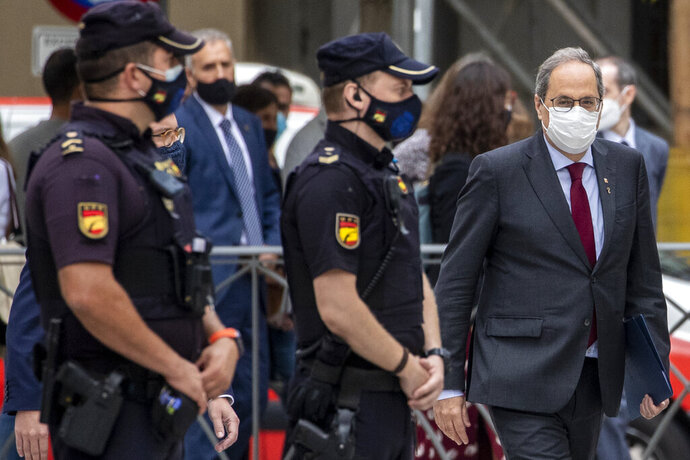 Catalan regional President Quim Torra arrives at the Spanish Supreme Court in Madrid, Spain, Thursday, Sept. 17, 2020.  Spain's Supreme Court is hearing closing arguments over whether to uphold or overturn the barring from public office of Catalonia's separatist-minded regional leader. (AP Photo/Manu Fernandez)